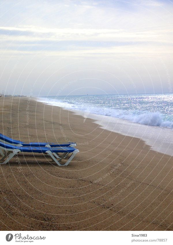 A deckchair rarely comes alone... Beach Ocean Waves Deckchair Vacation & Travel Loneliness Sunset Clouds Summer Think Spain Barcelona Barefoot Coast Sand Water