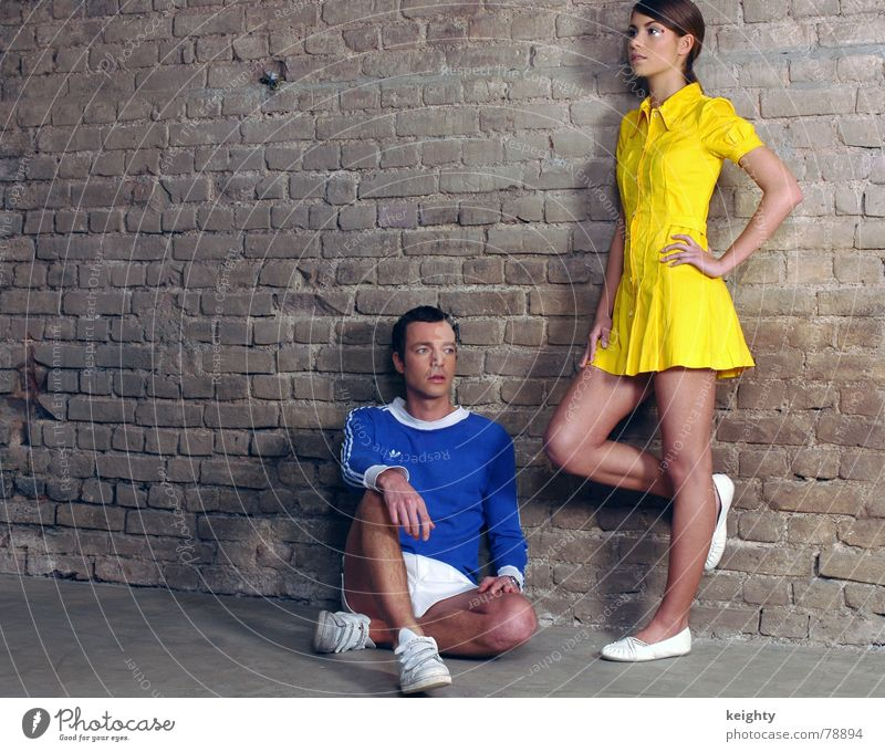 Woman Man Blue Yellow Wall (barrier) Footwear Sit T-shirt Stand Floor covering Dress Pants Concentrate Sneakers Support