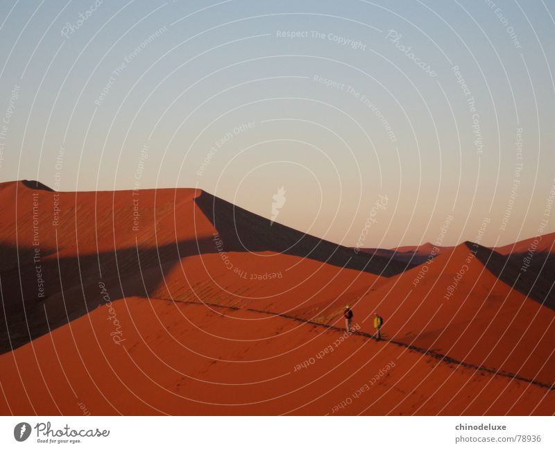 Dawn over the Namib Red Sunrise Morning Adventure Hiking Events Freedom Badlands Exciting Desert Namib desert dune 45 red sand soussesvlei people on dune Shadow