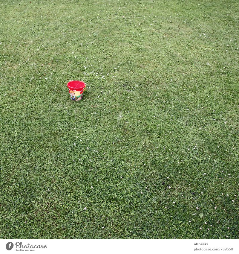 Small bucket Grass Garden Meadow Bucket Containers and vessels Toys Green Red Loneliness Infancy Colour photo Exterior shot Structures and shapes Deserted