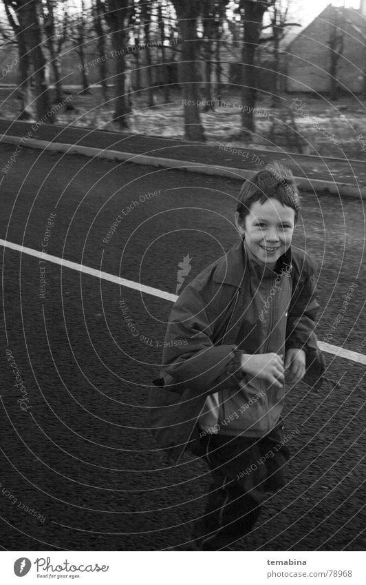 boy running Monochrome Riga Grinning Joy suburban smiling white street Black & white photo