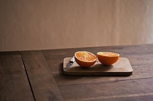orange Food Fruit Orange Nutrition Eating Organic produce Vegetarian diet Knives Chopping board Healthy Eating Fresh Delicious Natural Wooden table Appetite