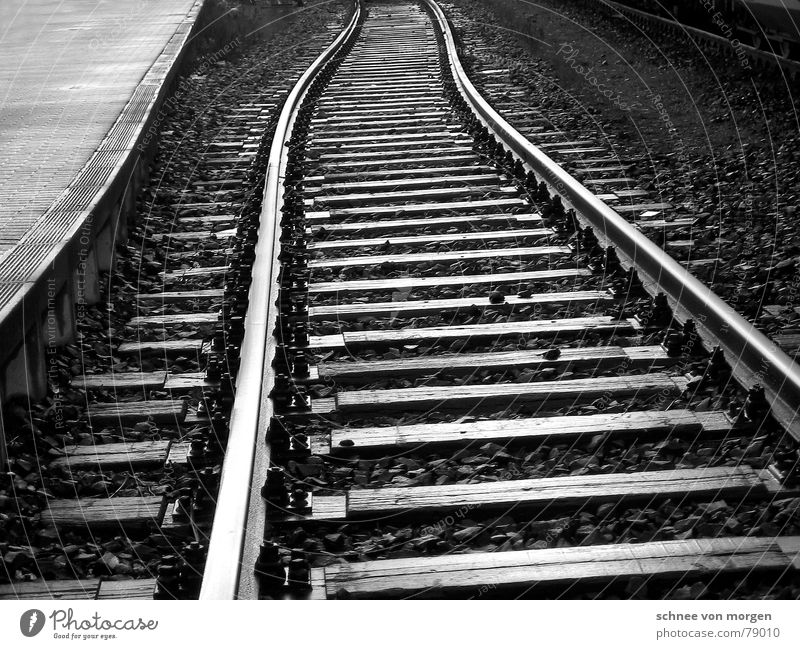 on the wrong track Vanishing point Side by side Long-winded Railroad tracks Plank Asphalt Vertical Infinity Black Gray Parallel Gloomy Badlands Engines