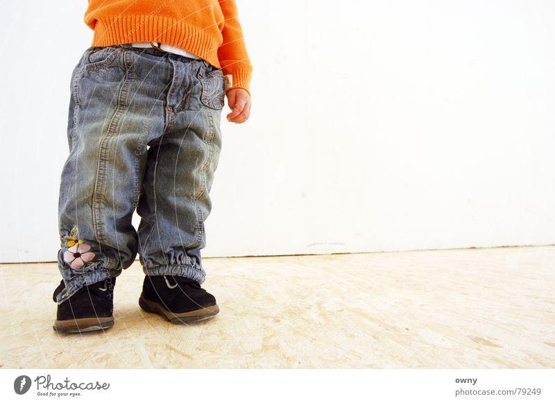 Child Hand Girl Flower Wall (building) Wall (barrier) Feet Footwear Small Jeans Floor covering Pants Stomach Hippie Belt Wooden floor