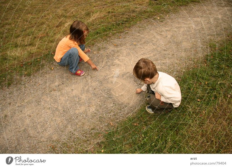 Human being Child Nature Green Girl Autumn Playing Grass Boy (child) Lanes & trails Stone Creativity Illustration Lawn Idea Image