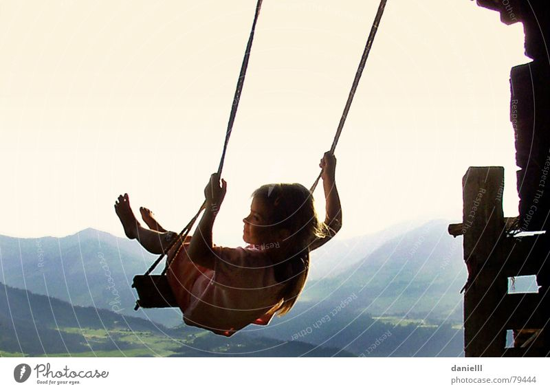 epicure Child Mountain Vacation & Travel Hut Girl Freedom Joy Swing To swing Alps Austrian Alps Federal State of Tyrol Dangerous Thrill Serene Alpine hut