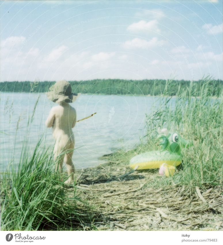 At the lake Dragon Lake Child Summer Beach Far-off places Toddler Bathing place Vacation & Travel Green Playing Swimming & Bathing Nature Sky Water