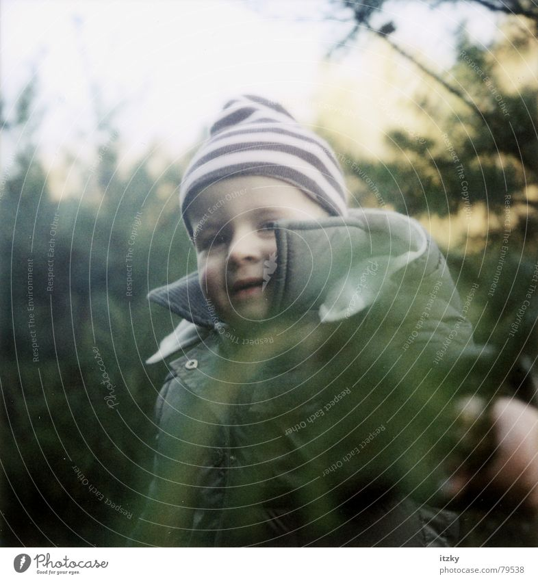 Rosa in the Wood Forest Child Green Playing Portrait photograph Cap Winter Nature polaroid ®