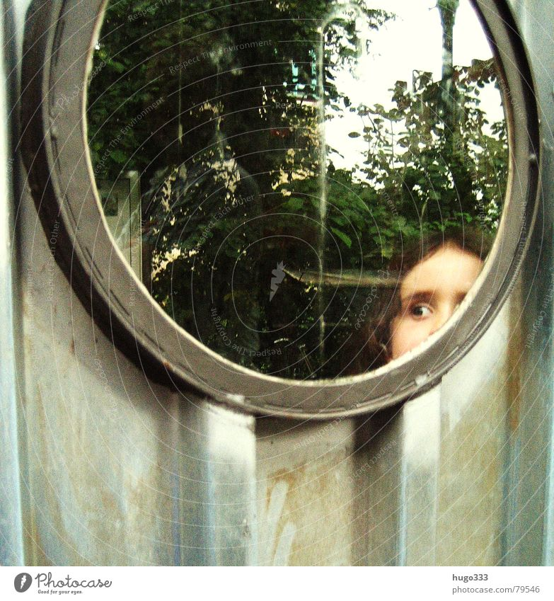 she's got the look Fleeting Brunette Child Window Corrugated sheet iron Wall (building) Curiosity Girl Round Porthole Reflection Looking Hollow Observe Dark