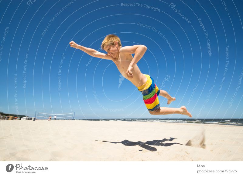 Human being Sky Child Vacation & Travel Water Summer Sun Ocean Beach Coast Boy (child) Freedom Sand Flying Power Infancy