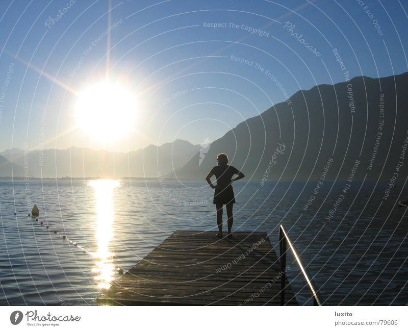 Enlightened Lake Woman Summer Longing Morning Sunrise Sky Nostalgia Clouds Loneliness Vacation & Travel Sunbathing Light Calm Beautiful Water Mountain Blue Dawn