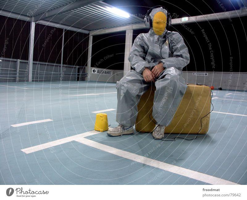 grau™ - sitting on a packed suitcase Parking garage Gray Yellow Gray-yellow Suit Rubber Art Stupid Futile Hazard-free Crazy Funny Joy Flashlight Headphones