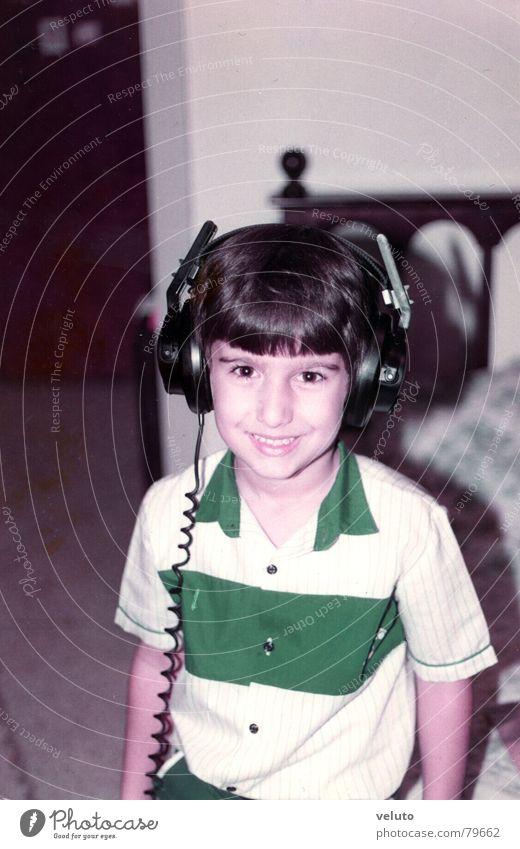 Joy Boy (child) Music Laughter Listening Grinning Headphones Child