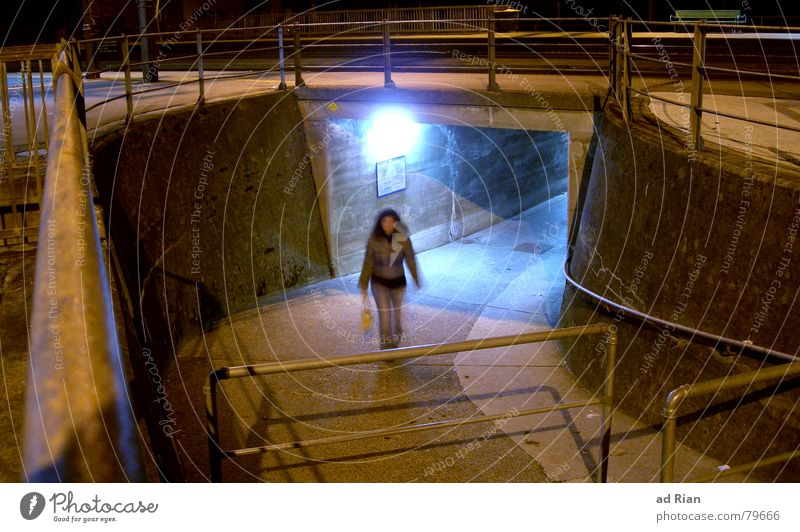 The light at the end of the tunnel Woman Adults 1 Human being Warmth Train station Bridge Tunnel Wall (barrier) Wall (building) Stairs Bag Walking Dream Dark
