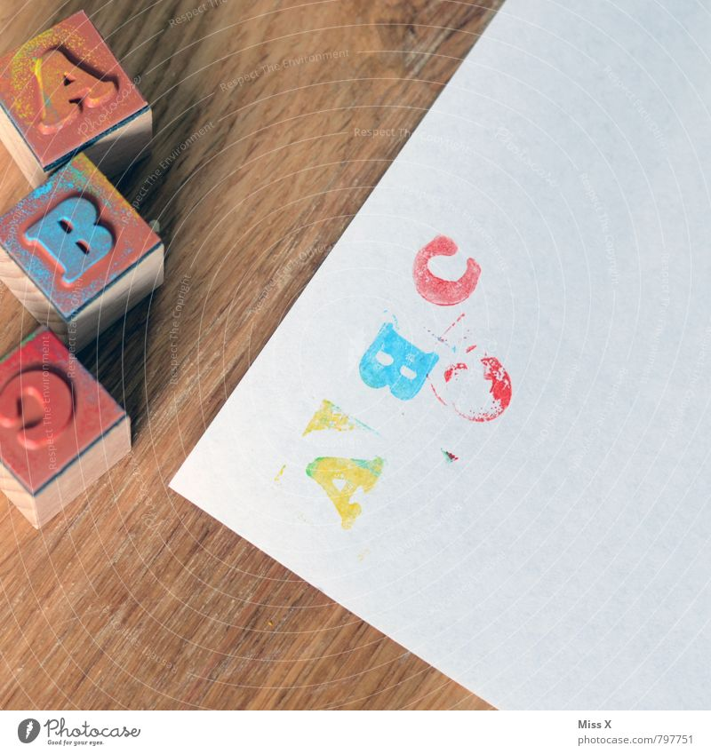 Child Playing School Leisure and hobbies Infancy Characters Study Paper Reading Education Student Kindergarten Handicraft Stamp Schoolchild Latin alphabet