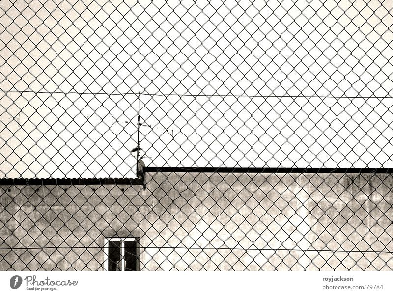 constrictive sight Penitentiary Convict Jail sentence Obstinate Fence Building Window Captured Antenna Gray Wall (building) Wire netting fence Sky Window board