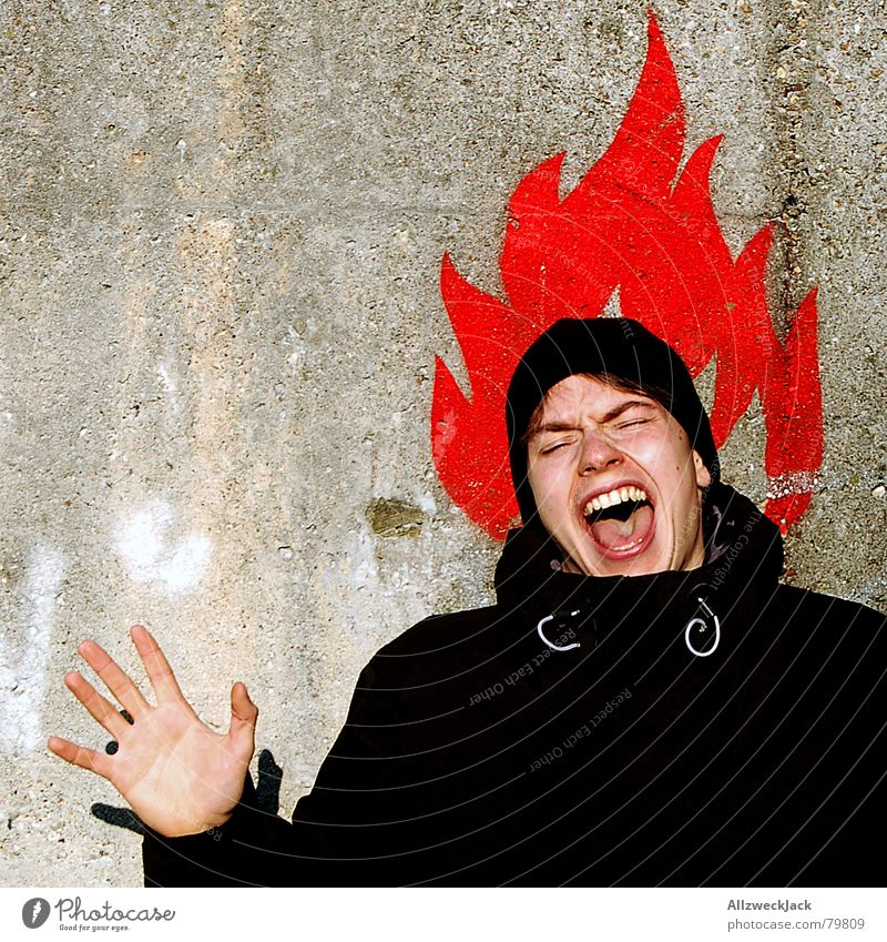 Human being Man Hand Youth (Young adults) Red Face Wall (building) Wall (barrier) Graffiti Blaze Scream Pain Symbols and metaphors Guy Flame Warning label