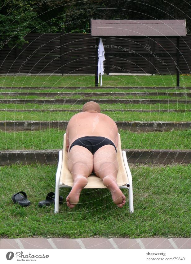 Even a back can delight. Fat Lie Voluminous Bathing meadow Bottom Bald or shaved head Indifferent Couch Swimming trunks Large Force Plump Round Strong Firm Thin