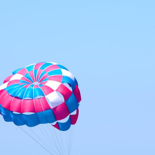 shade Joy Leisure and hobbies Tourism Freedom Summer vacation Flying Athletic Multicoloured Adventure Risk Sports Parachute Colour photo Exterior shot Deserted