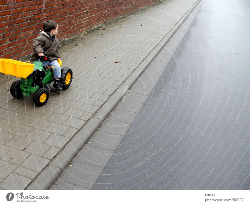 Child Vacation & Travel Loneliness Joy Winter Cold Yellow Wall (building) Street Lanes & trails Boy (child) Wall (barrier) Playing Masculine Fresh To enjoy