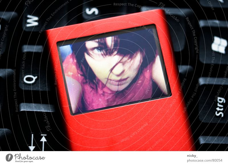 Woman Computer Girl Red Black Child Hair and hairstyles Media Music Photography Nose Letters (alphabet) Touch Screen Radio (broadcasting) Evil