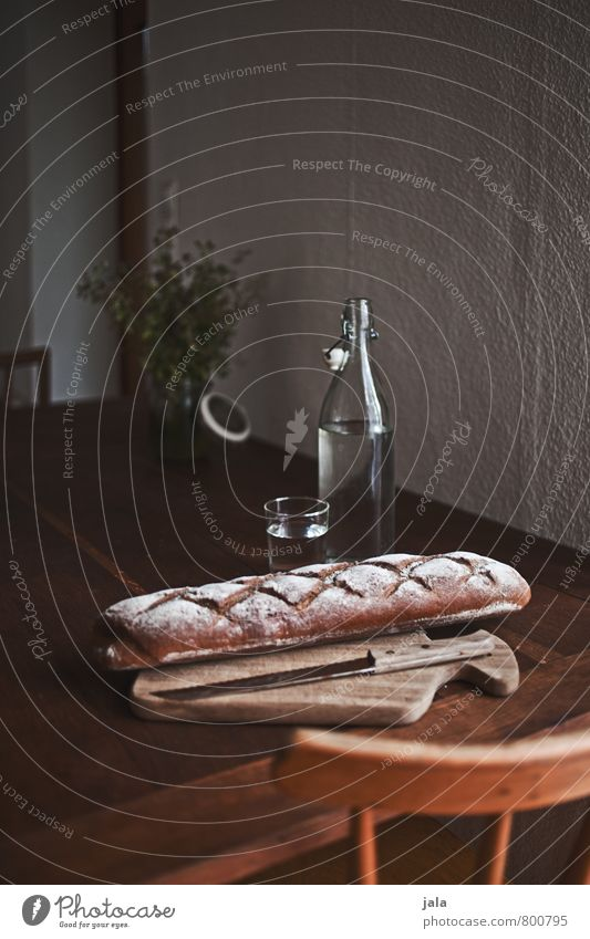 kitchen table Food Bread Nutrition Organic produce Vegetarian diet Beverage Cold drink Drinking water Bottle Glass Knives Chopping board Healthy Eating Chair