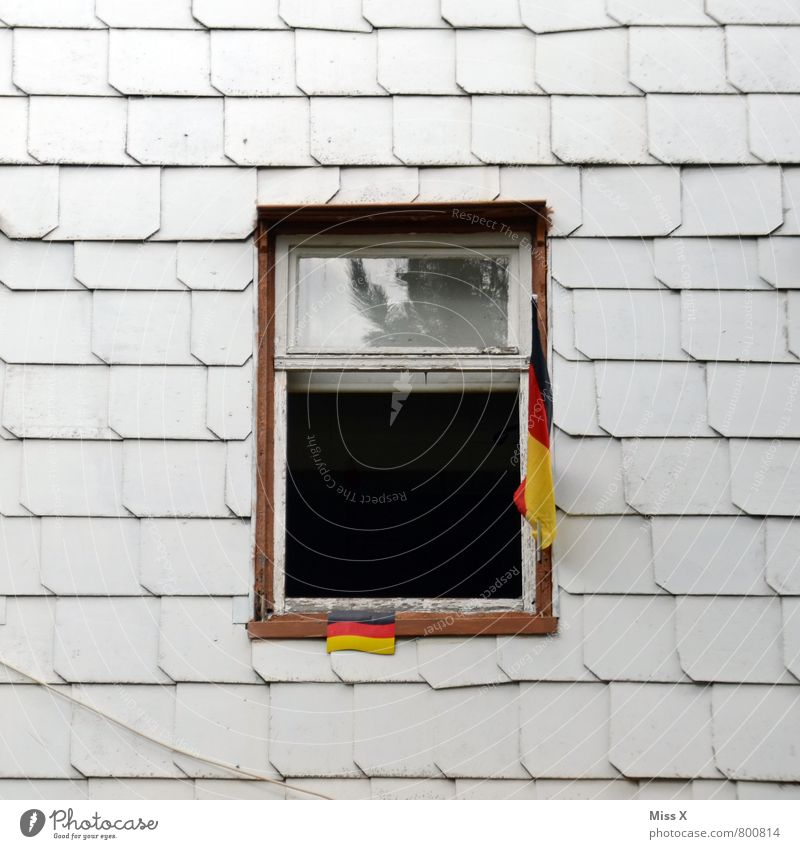 House (Residential Structure) Window Wall (building) Senior citizen Wall (barrier) Flat (apartment) Facade Living or residing Decoration Poverty German Flag End