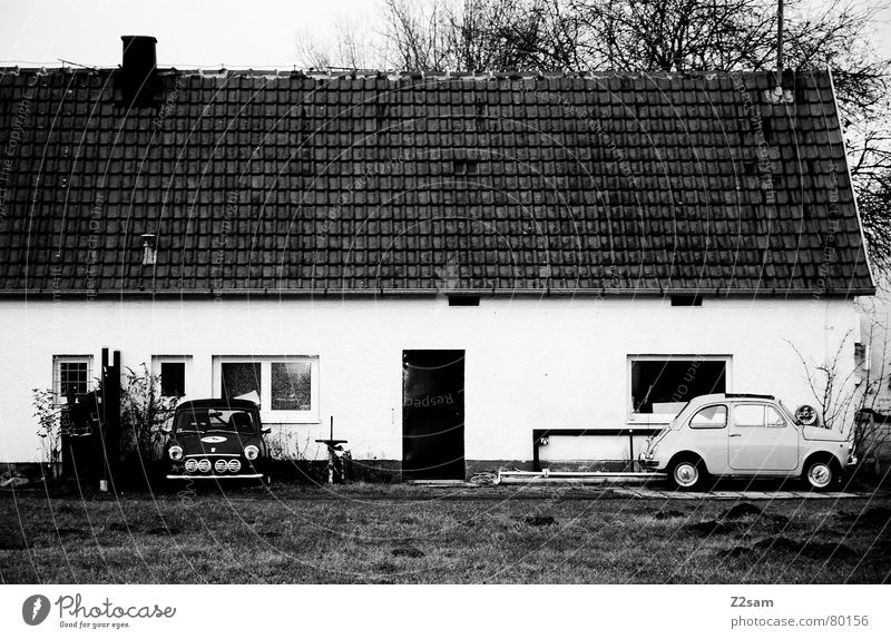 minis Small car Carriage Vehicle Parking Window House (Residential Structure) Meadow Black/White Outside the door. bmw Door Black & white photo Location