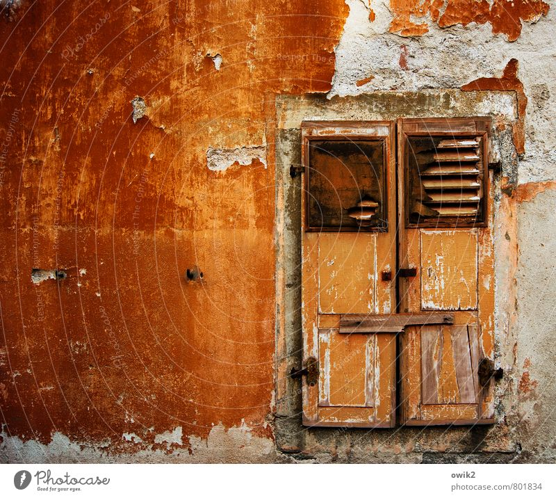 care level Deserted House (Residential Structure) Wall (barrier) Wall (building) Facade Window Shutter Closed Barricaded Illuminate Old Glittering Gloomy Orange
