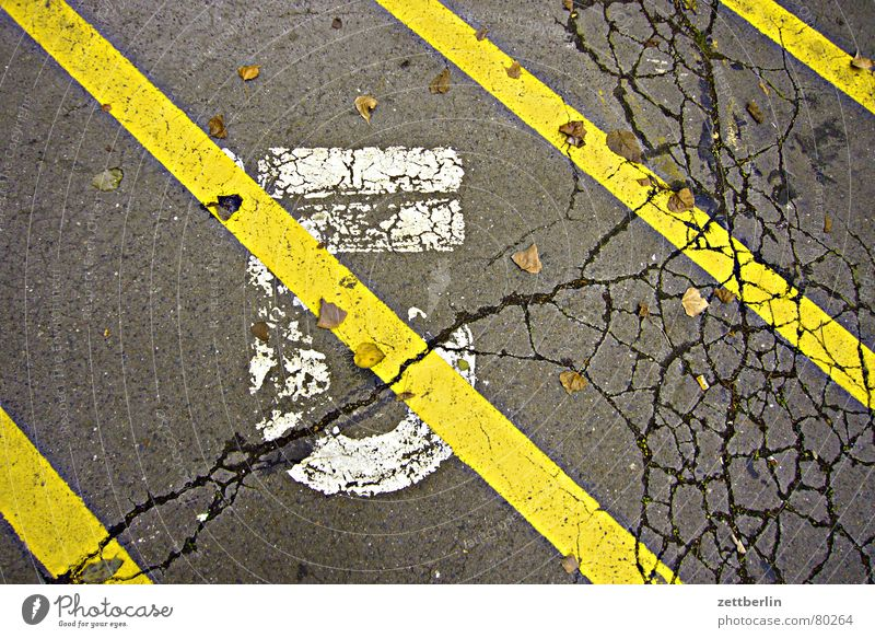 Yellow Street Jump Line Signs and labeling Digits and numbers Asphalt Stripe Painting (action, work) Sign Signage Symbols and metaphors Parking lot Crack & Rip & Tear Furrow Pavement