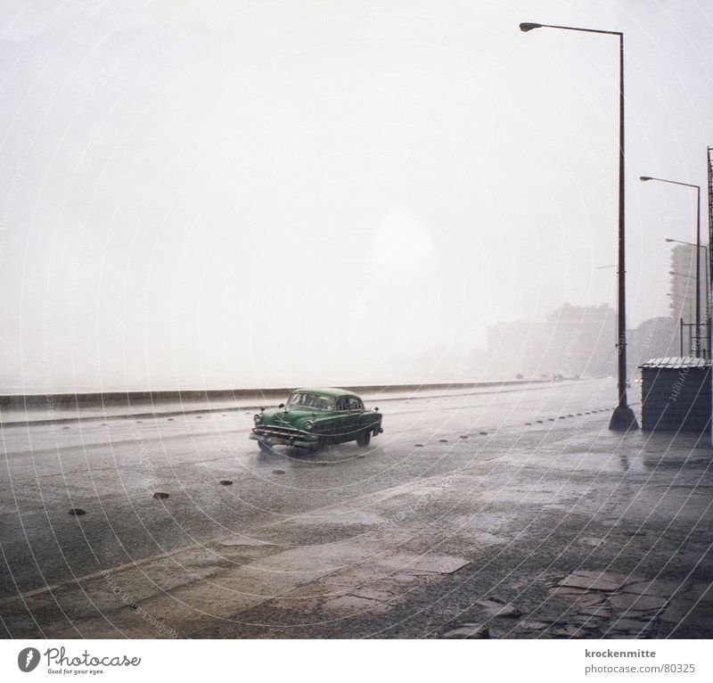 Malecon Vintage car Rain Lantern Loneliness Vacation & Travel Cuba Wet Dreary Asphalt Havana El Malecón Carriage Weather Thundery shower Damp Pavement Transport