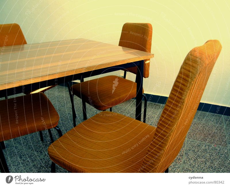 Between the chairs Colour photo Detail Furniture Chair Table Education Work and employment Meeting Old Think Communicate Sit Retro Bolster Empty Wall (building)