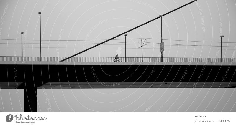 Between oblique and target Antisocial Loneliness Geometry Lamp Black Transport Road traffic Gloomy Deserted Bridge pier Bicycle Vacation & Travel Poverty