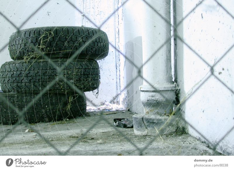 tire stacks Garage Fence Shaft of light Dust Long exposure Metal spiderweb