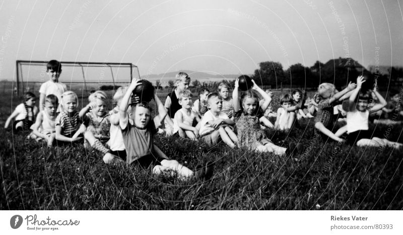 gym lesson Sports team Ball sports Child Girl Sporting grounds Village Gymnastics Sporting event Lessons Grass Meadow Soccer Goal The fifties Group Fitness