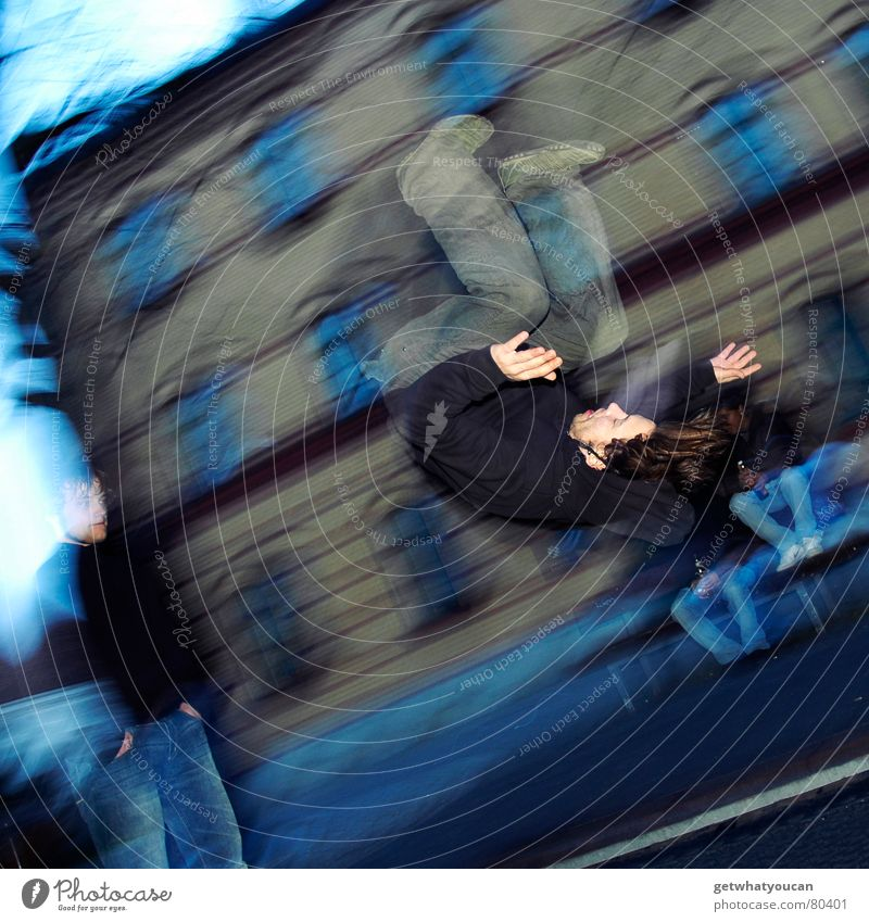 And it's turning, isn't it? Trampoline Reckless Man Salto Jump Gymnastics Leisure and hobbies Town Blur Action Flash photo Young man Human being Playing