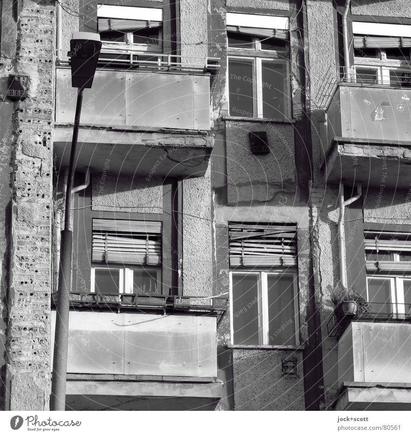 Renewed upturn in restructuring intentions Prenzlauer Berg Facade Balcony Window Retro Gloomy Decline Past Change Lantern Venetian blinds Old building Shabby