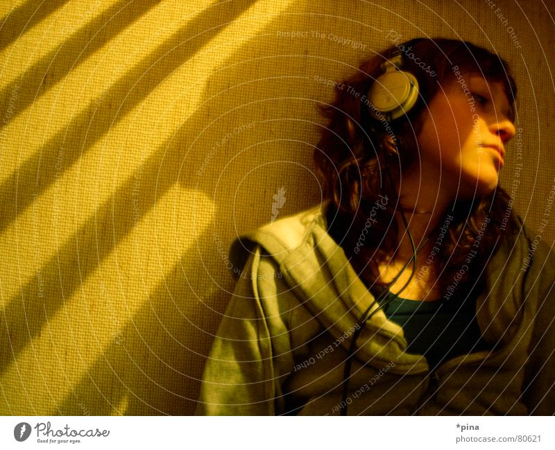 thinking about Woman Thought Dream Occur Go under Headphones Remember Absentminded Light Think Listen to music Emotions Relaxation Listening Music Shadow
