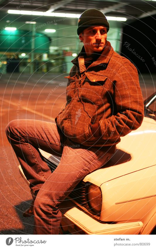 sitting waiting wishing Night Parking lot Light Flexible Man Easygoing Jacket Winter Cold Date Cap Scarf Supermarket Human being Evening Car Old