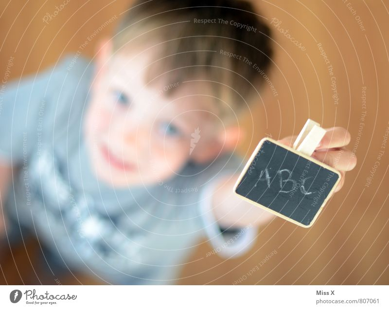 abc Parenting Kindergarten Child School Study Classroom Blackboard Schoolchild Student Human being Boy (child) Infancy 1 3 - 8 years Characters Smiling Write