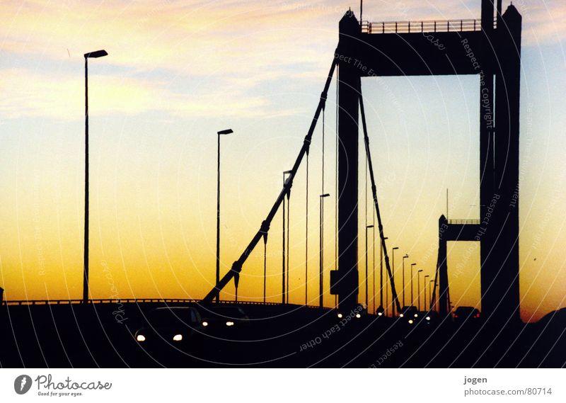 Homberg - Skyline Ruhrort North Rhine-Westphalia Motoring Back-light Strong Motionless Yellow Black Bridge pier Evening sun Duisburg Sunset Dusk Lamp post