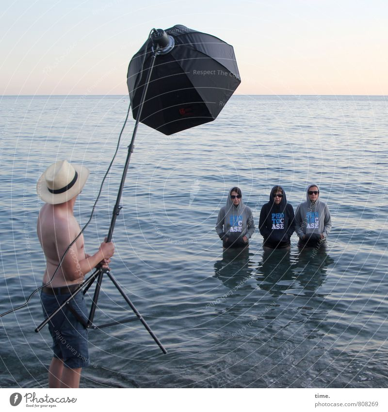 best boy on set Technology 4 Human being Art Stage play Actor Event Water Sky Horizon Waves Coast Beach Ocean Mediterranean sea T-shirt Sunglasses Hat