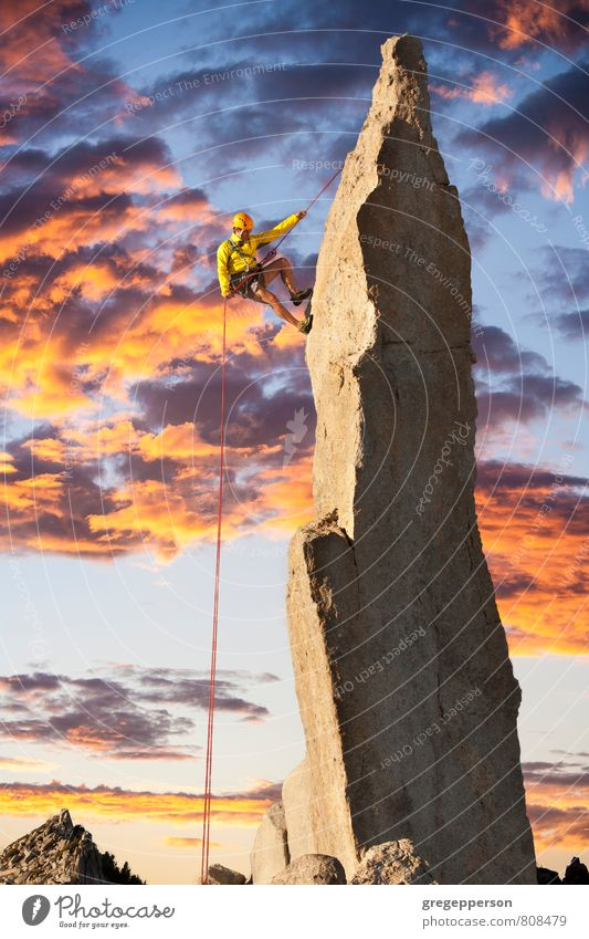 Climber tiptoes on the edge. Adventure Climbing Mountaineering Success Rope Man Adults 1 Human being 30 - 45 years Clouds Peak Helmet Self-confident Brave