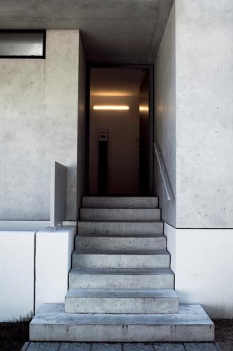 entrance House (Residential Structure) Manmade structures Building Architecture Wall (barrier) Wall (building) Stairs Door Concrete Sign Characters