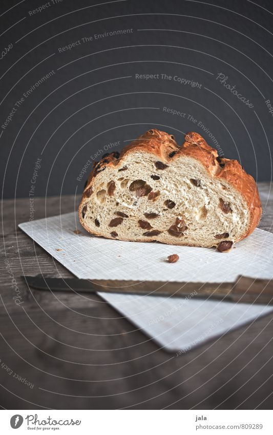 mares with raisins Food Dough Baked goods Cake Nutrition Breakfast To have a coffee Vegetarian diet Knives Chopping board Fresh Delicious Natural Colour photo