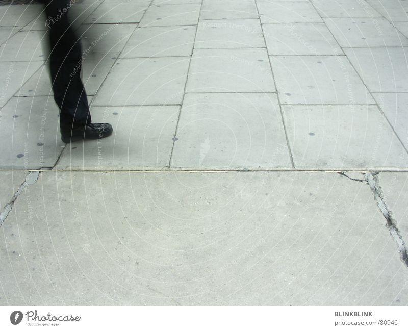Human being Man Black Street Gray Movement Legs Feet Footwear Going Walking Concrete Floor covering Pants Obscure Furrow