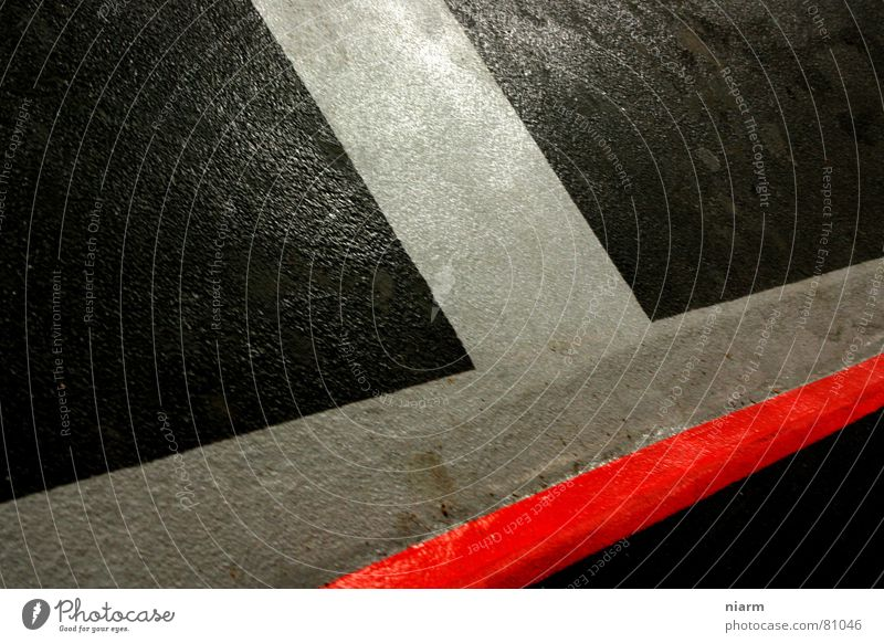 A real hatchka. Constructive Overwhelming T Handbook Otherwise Red Black Diagonal Composing Abstract Line Asphalt Gray Parking garage Simplistic Formation