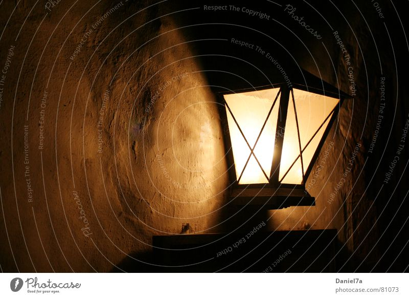 wall lamp Sympathy Structural change Light Glittering Dark Autumn Cozy Wall (building) Lantern Lamp Plaster Morning Well-being Evening Shadowy existence