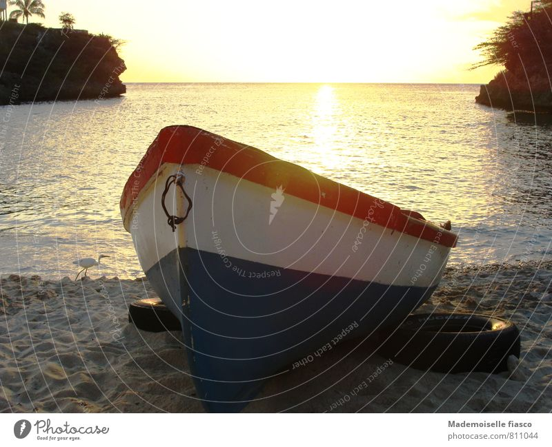 Fishing boat in the sand on the beach Sand Water Sunrise Sunset Summer Beach Ocean Boating trip Relaxation Calm Colour photo Copy Space top Evening
