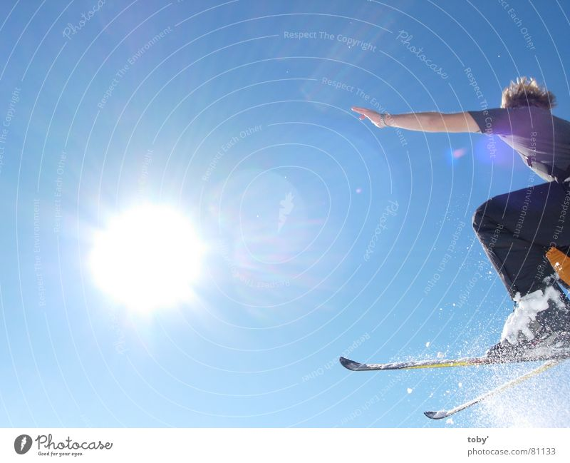 flying into the sun Light Jump Sports Playing Sun Joy Sky Snow Blue Skiing